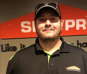 Male wearing SERVPRO hat and shirt