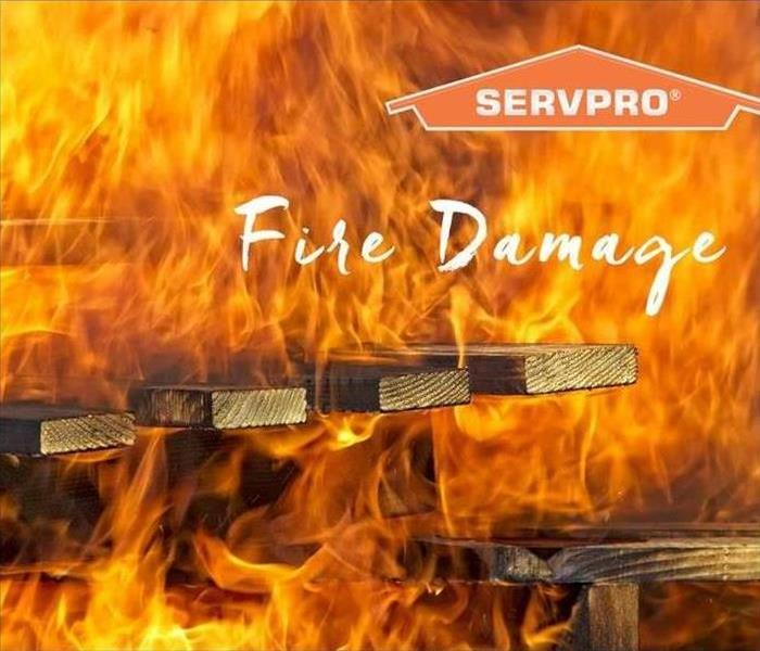 Wood on fire with SERVPRO logo